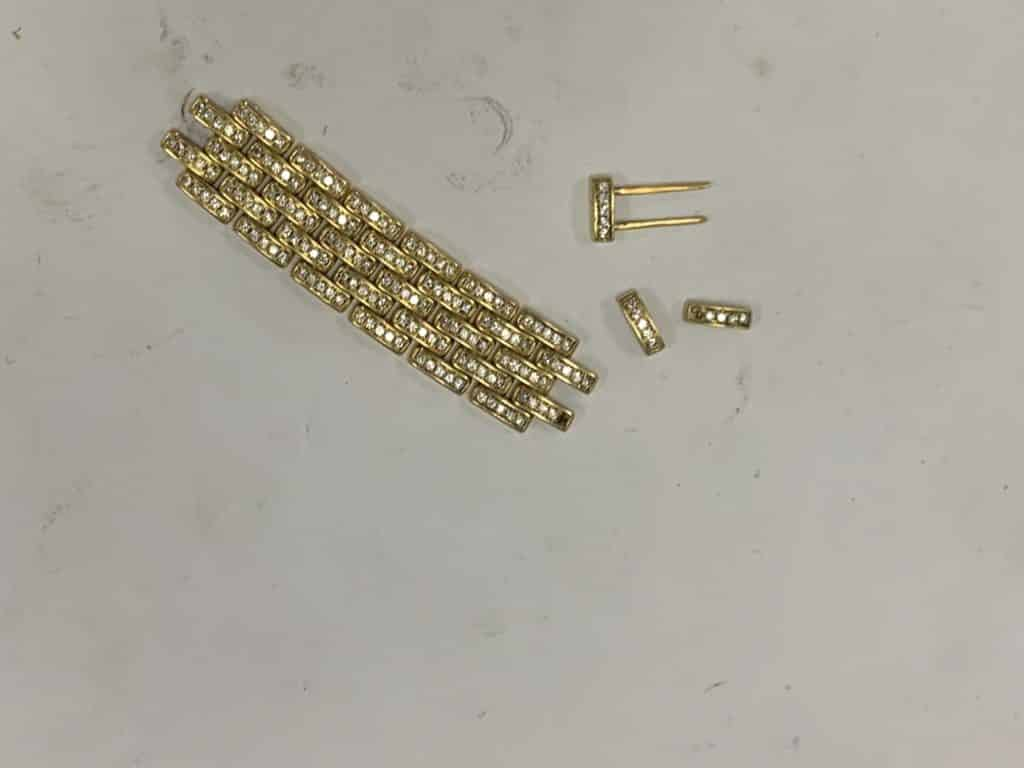 Cartier watch links dismantled